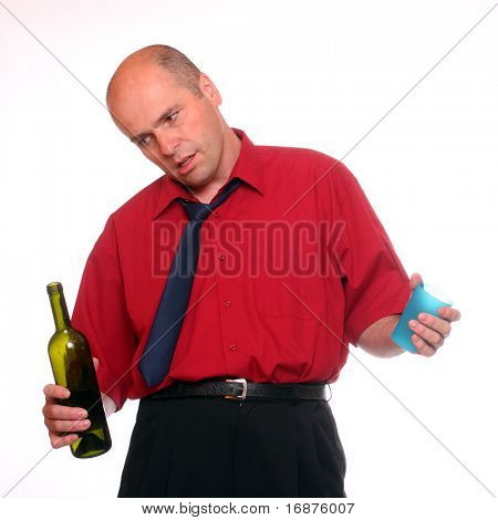 Drunken businessman holding a wine bottle