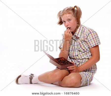 Young girl with chocolate candy.