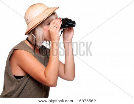 Young woman watching closely wildlife with his binoculars. Studio shot isolated on white background