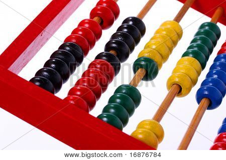 Wooden abacus. Essential tool for schoolchildren. Close up with shallow DOF.