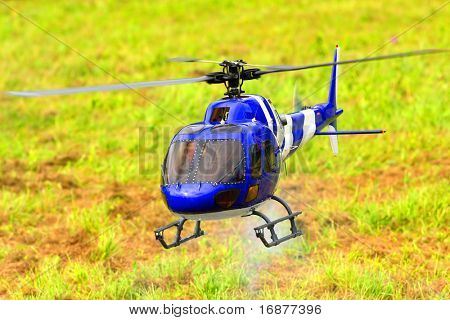 Flying helicopter (radio controled scale-model 1:24 scale) Teleobjective shot with shallow DOF.