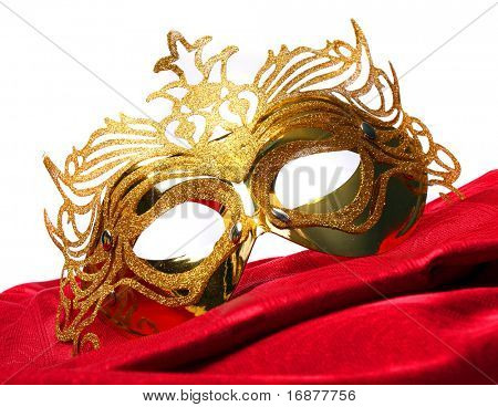 Decorated mask for masquerade on white background. Great for halloween brochures and advertisements. Unauthorized homemade paper product.