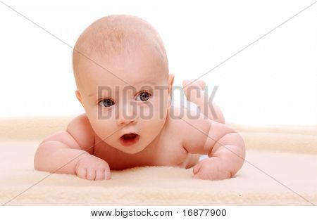 Cute baby on a plushy blanket.