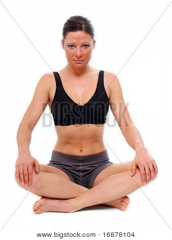 Shot of a sporty young woman sitting in yoga pose. Active lifestyle.
