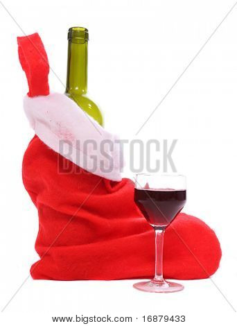 Red santa claus stocking with wine bottle and glass