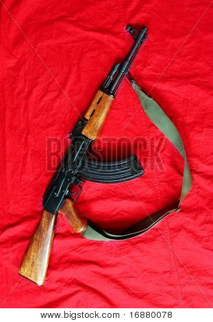 The assault rifle traditional weapon for terrorist guerrilla isolated on a red background.