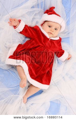 Cute baby dressed as Santa on a blanket. Great for calender and christmas greetings.