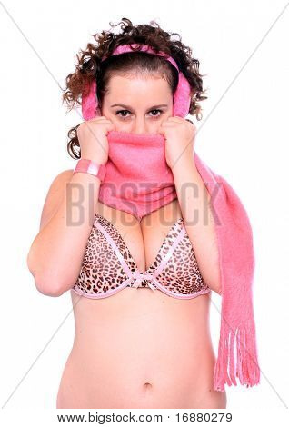 Young woman with plushy ear muffs and pink muffler.