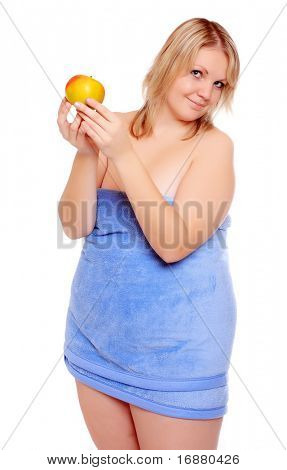 Picture of overweight woman with fresh ripe apple.