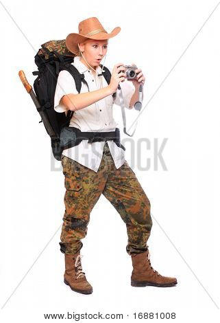 Young traveller with digital camera dressed on safari suit.