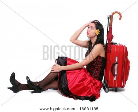 Worried young woman waiting at the airport terminal. Delay of flight.