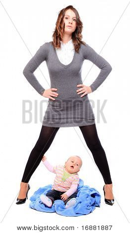 Young successful businesswoman with here little baby. Feminist metaphor.