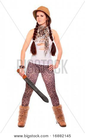 Young sexy woman dressed in panther leather with tropical helmet holding big cutlass on a white background.