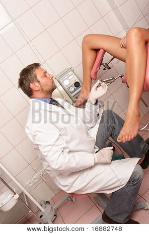 Gynecologist performing patient's examination