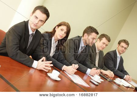 Conference, group of 5 business people sitting at the big table
