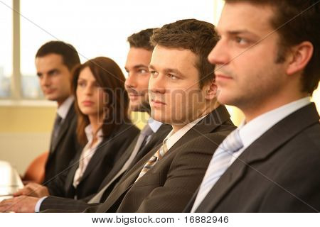 five business people at the meeting - debate