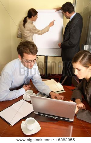 Presentation. Business people working in the office - 2 man, 2 woman