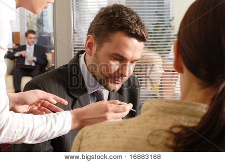 Professional businesspeople in an office environment.