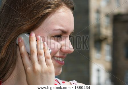 Smiling Teen Girl With Cell Phone
