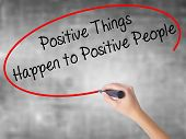 Постер, плакат: Woman Hand Writing Positive Things Happen To Positive People With Black Marker Over Transparent Boar