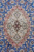stock photo of tabriz  - fine detail of persian classic carpet background - JPG