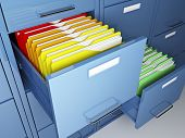 stock photo of file folders  - file cabinet detail and colorful folder - JPG