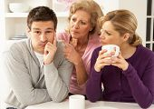 stock photo of mother law  - Senior Mother Interfering With Couple Having Argument At Home - JPG