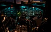 image of longbow  - The cockpit of a Chinook helicopter at night with lights glowing - JPG