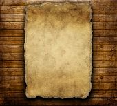 stock photo of wild west  - old paper on brown wooden texture - JPG