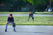 stock photo of little-league  - Young boy ready for the play on 3rd base - JPG