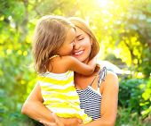 Beautiful Mother And her little daughter outdoors. Nature. Beauty Mum and her Child playing in Park  poster