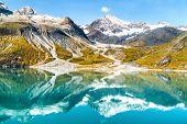 Glacier Bay National Park, Alaska, USA. Amazing glacial landscape showing mountain peaks and glacier poster