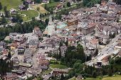 Cortina d'Ampezzo is the most charming ski resort in Italy. Cortina is also known as the