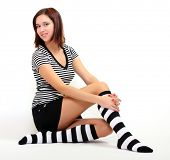stock photo of mini-skirt  - Sexy girl in funny socks posing on her knees - JPG