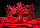 stock photo of masquerade mask  - Decorated mask for masquerade on red velvet - JPG