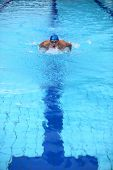 dynamic swimmer in swimming pool
