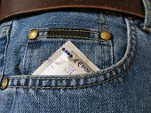 picture of venereal disease  - Condom in the front pocket of a blue jean - JPG