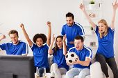 friendship, sport, people and entertainment concept - happy friends or football fans watching soccer poster