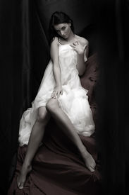 picture of striper  - Beautiful slenderness young woman in bridal veil on black background - JPG