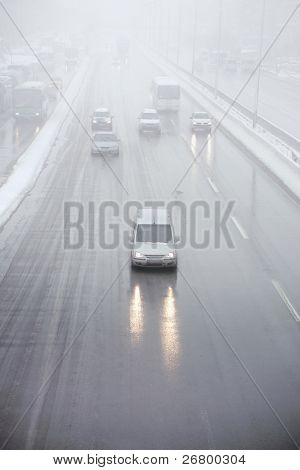 an image of cars on the road