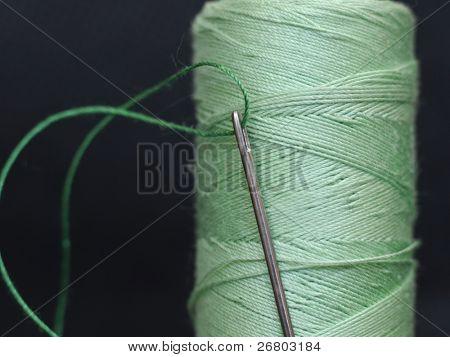 needle in green bobbin on black