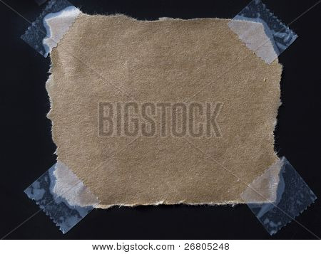 piece of paper with sticky tape on black background
