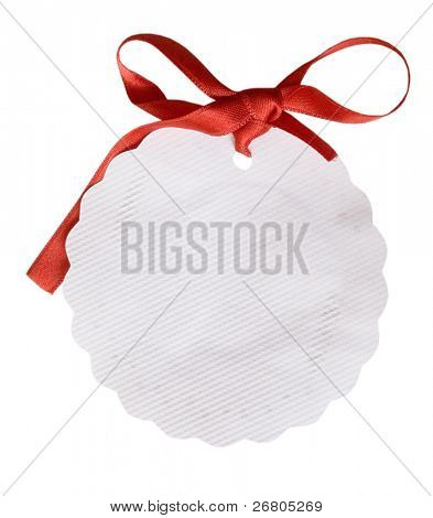 oval white tag with red bow