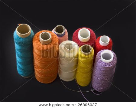 collection of colorful bobbins