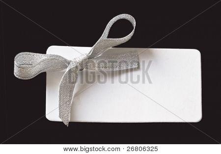 tag with silver bow