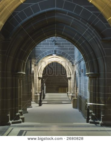 Looking Through A Series Of Arched Sandstone Doorways In Ancient Cathedral