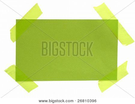 green paper note with green sticky tape