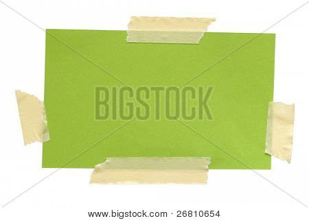 green paper note with sticky tape isolated on white background