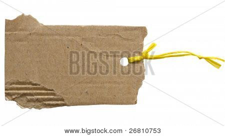 cardboard corrugate paper tag with yellow string isolated on the white background