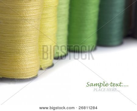 colorful bobbins with the place for your text
